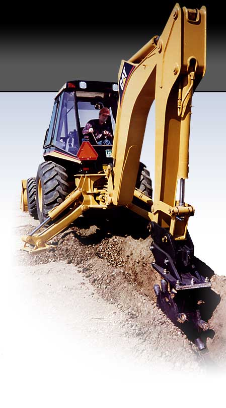 Backhoe with Barone Care-Free Compaction wheel attachment compacting dirt and soil in trench after excavation and installation of utilities.